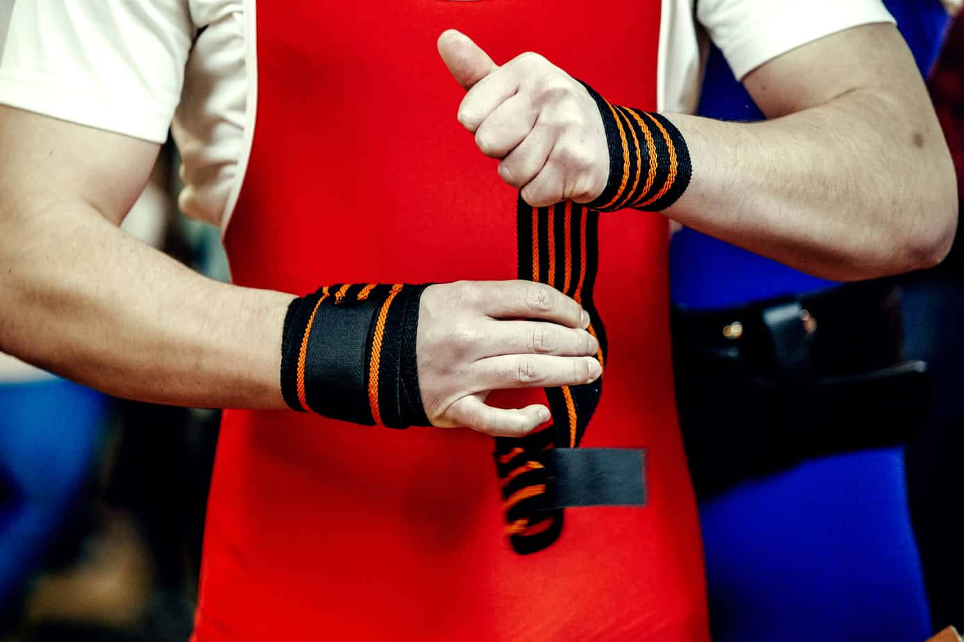 athlete powerlifter hands in wristbands
