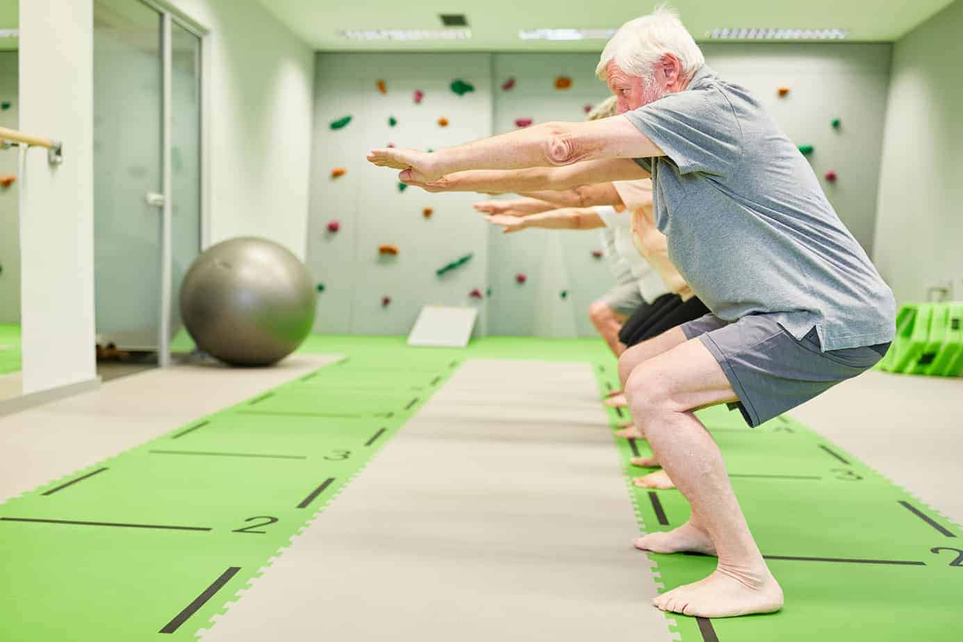 elderly bodyweight exercise class squat