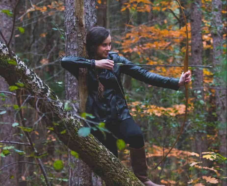 female longbow archer in the woods